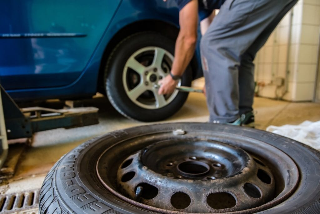 Checking a tire at Beck's Auto Center