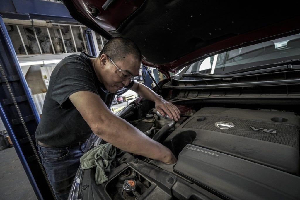 Beck's auto center technician performing maintenance